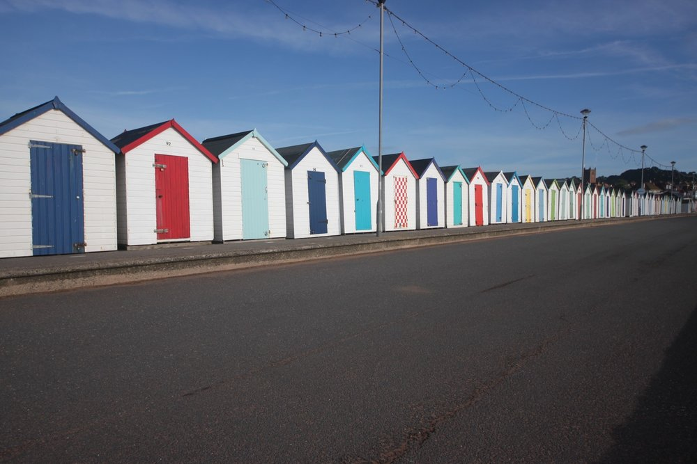 colourful beach huts on preston sands