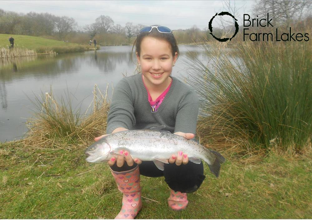 Chloe Cook from Hove, winner of Brick Farm Lakes Junior Troutmasters 2011/12 fish-off at Brick Farm Lakes with a 2lb 8oz rainbow.