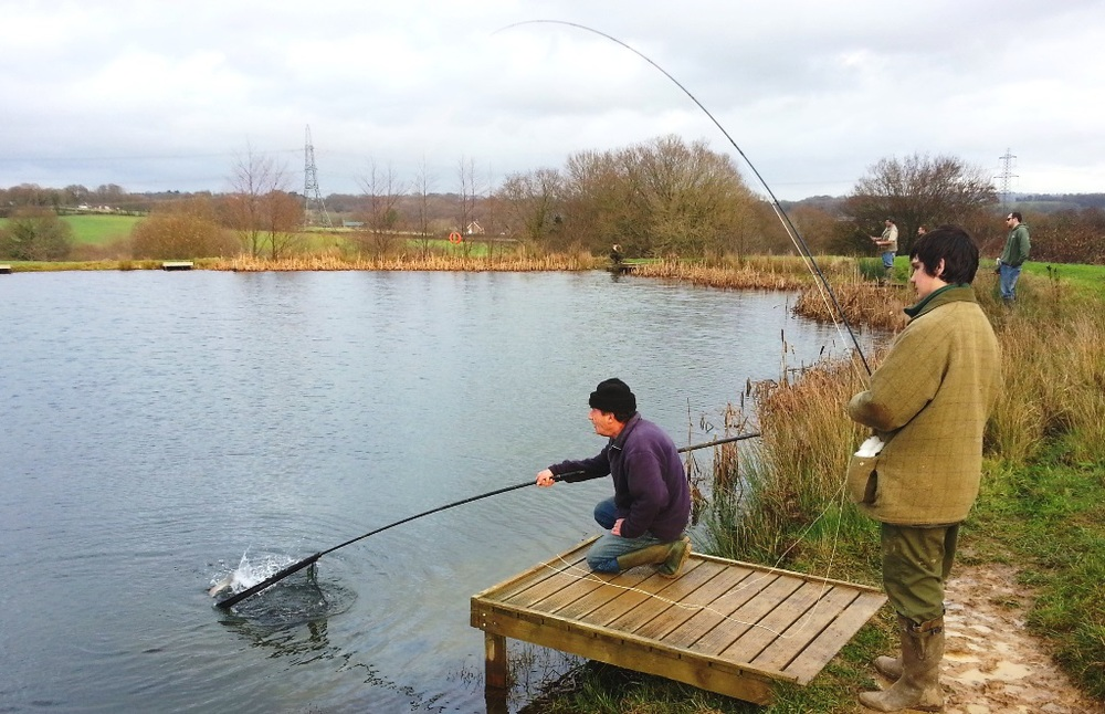 Students from Plumpton Agricultural College learning to fly-fish at Brick Farm Lakes