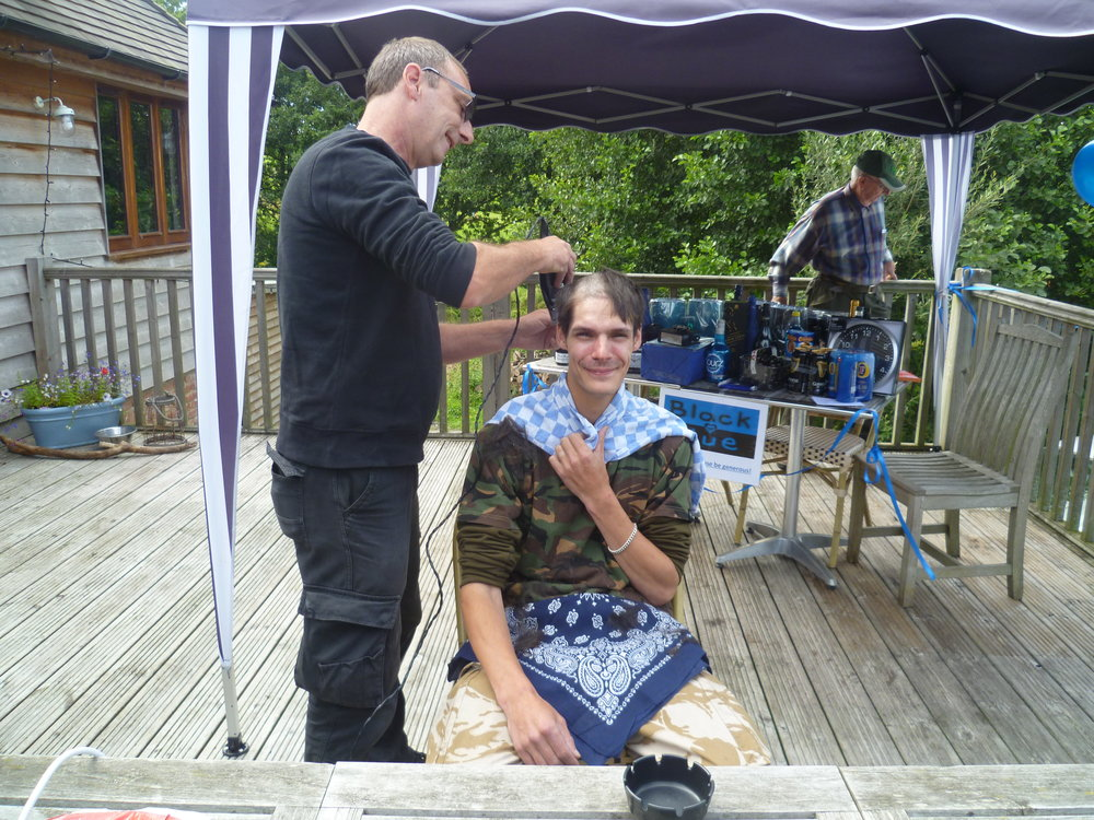 Keith Holford having his head shaved in aid of the tramper fund!!