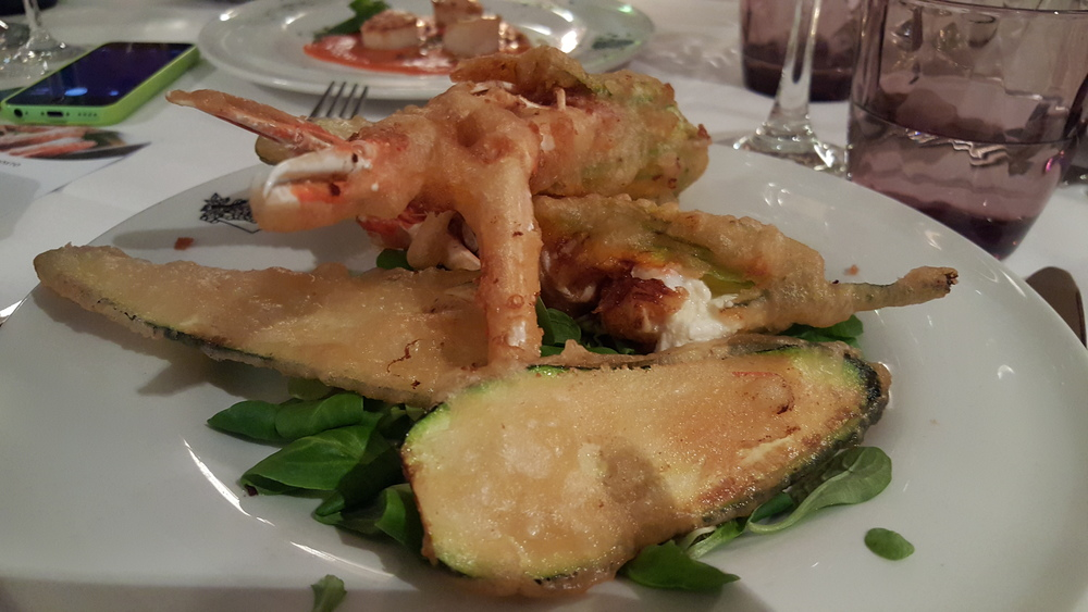 Fried zucchini flowers filed with crustaceans