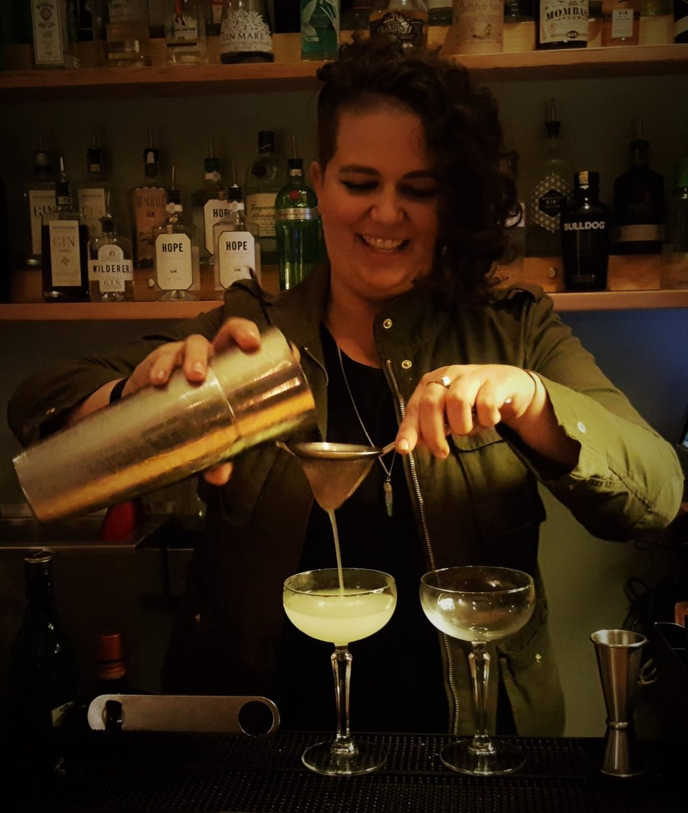 Caitlin pours two delicious Corpse Reviver no. 2 cocktails