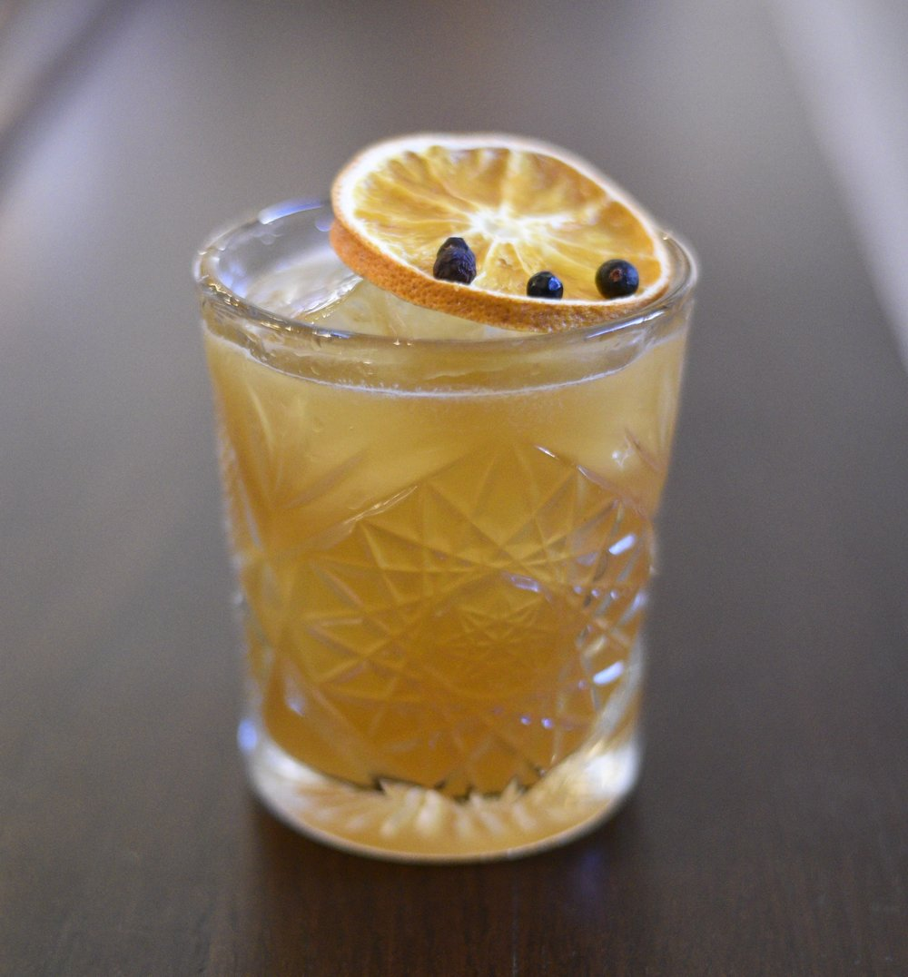 The Matthew's Gland: Mezcal, piemiento liqueur, lime, agave syrup, slice of orange