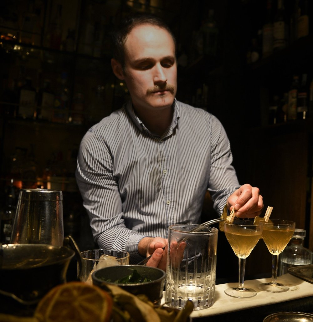 Devin prepares two Signet drinks