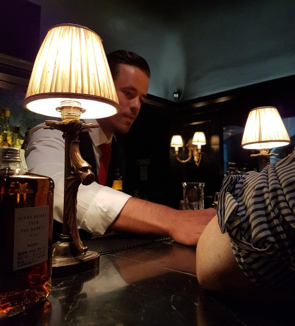 Alessandro Zampieri prepares a drink for Mirko