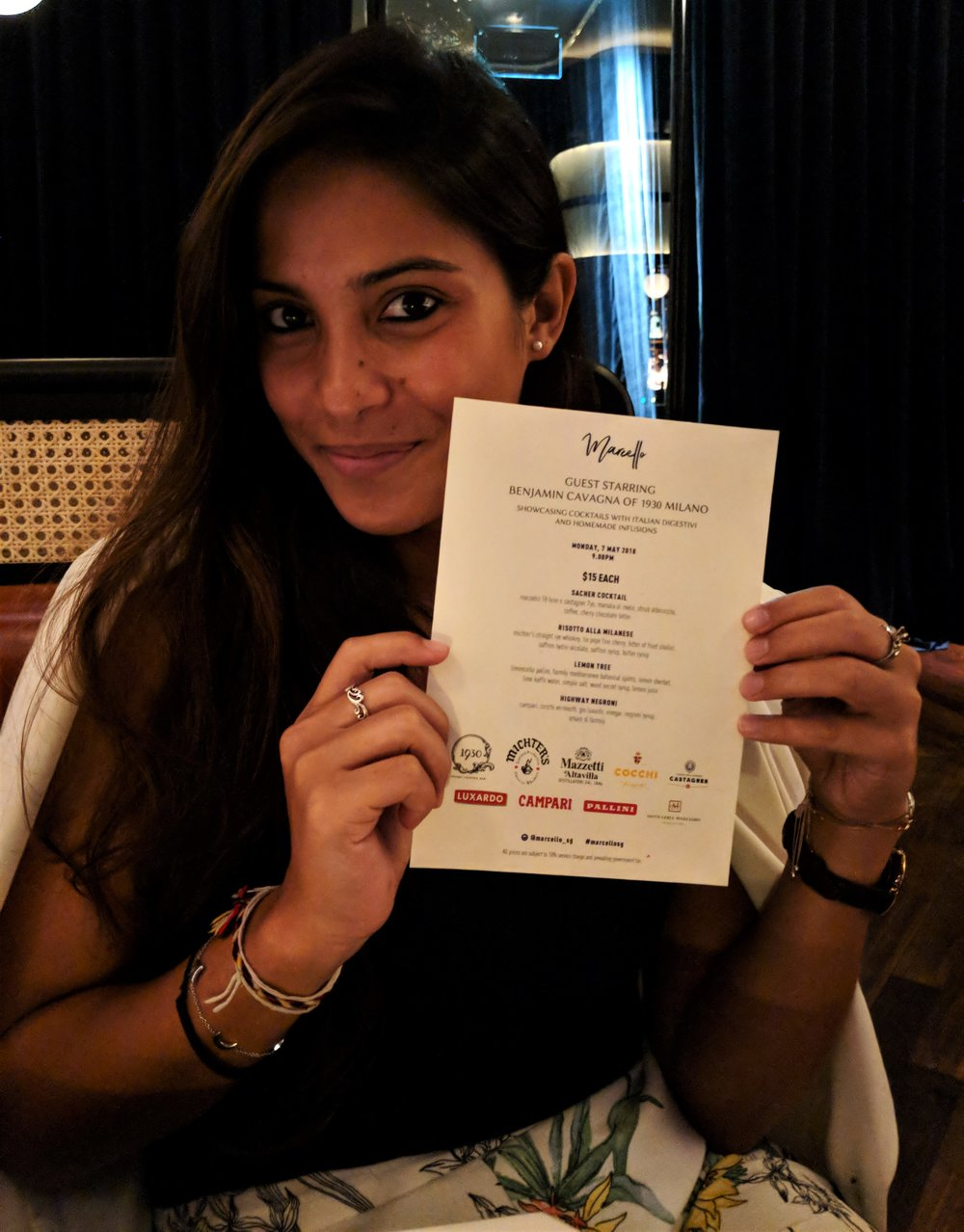 The beautiful Lorraine showing off the menu at Marcello
