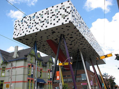 It's hard to miss the college's pixelated tabletop extension, perched on 12 multi-coloured legs 26 metres above the street.   Containing two stories of teaching space and studios, architect Will Alsop's striking design was praised for its imagination and boldness.   Art students rejoice!