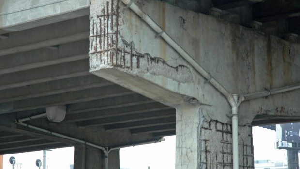 The concrete has flaked away from a column supporting a section of the Gardiner Expressway just west of Strachan Avenue. The steel rusts and expands, causing the concrete to flake away. (Andrew Lupton/CBC)