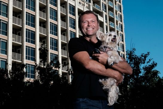 Garry Bradamore, president of PooPrints CDN, and Winston, his girlfriend's Morkie, in June Callwood Park. His company is aiming to help catch dog owners who don't pick up after their pets in Toronto.