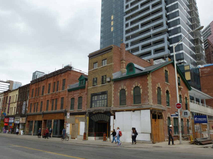 The Toronto Star:Yonge and St. Joseph St., where MOD Developers has opted to build its condo towers atop a historic warehouse just behind a historic block of Yonge st. and have specialized heritage architects meticulously restore/build the stores in front of the condo tower.(SUSAN PIGG)