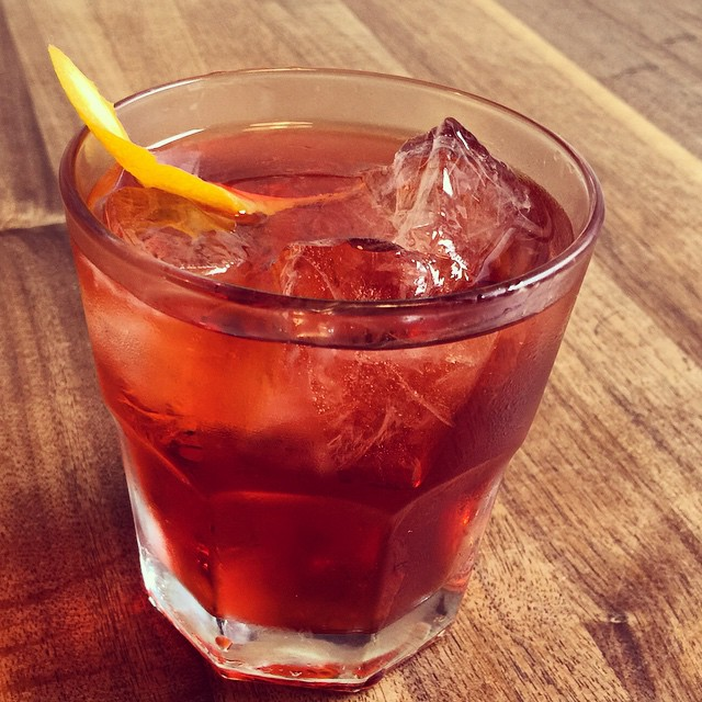 "Enjoy a rich, full bodied drink with character ""OAXACA NEGRONI"" mezcal, campari, carpano antica formula, flamed orange expression #negroniweek #negroni #mezcal #campari #labotaneria #parkslope #mixiology #brooklyn"