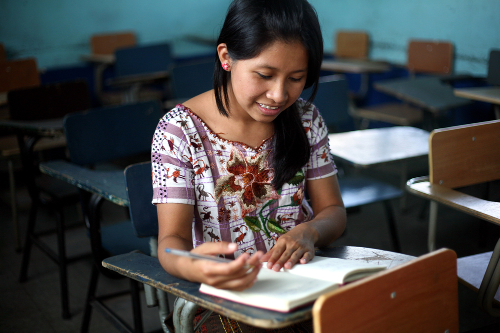Francisca in her classroom. She will graduate high school in October, and will be the first person in her family to graduate high school.