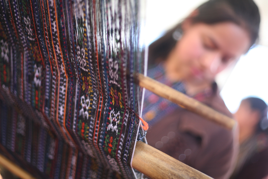Irma Josefina Ajcalon Cota demonstrates traditional weaving during a Starfish One by One mentoring session.