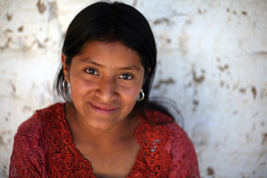 Ana Teresa Julujuj, 13, poses at her home in San Isidro, Guatemala. She's starting the 7th grade and is further along in her education than anyone else in her family. Full disclosure: I am sponsoring her education, along with my She's the First colleagues Christen Brandt and Maisy Page.