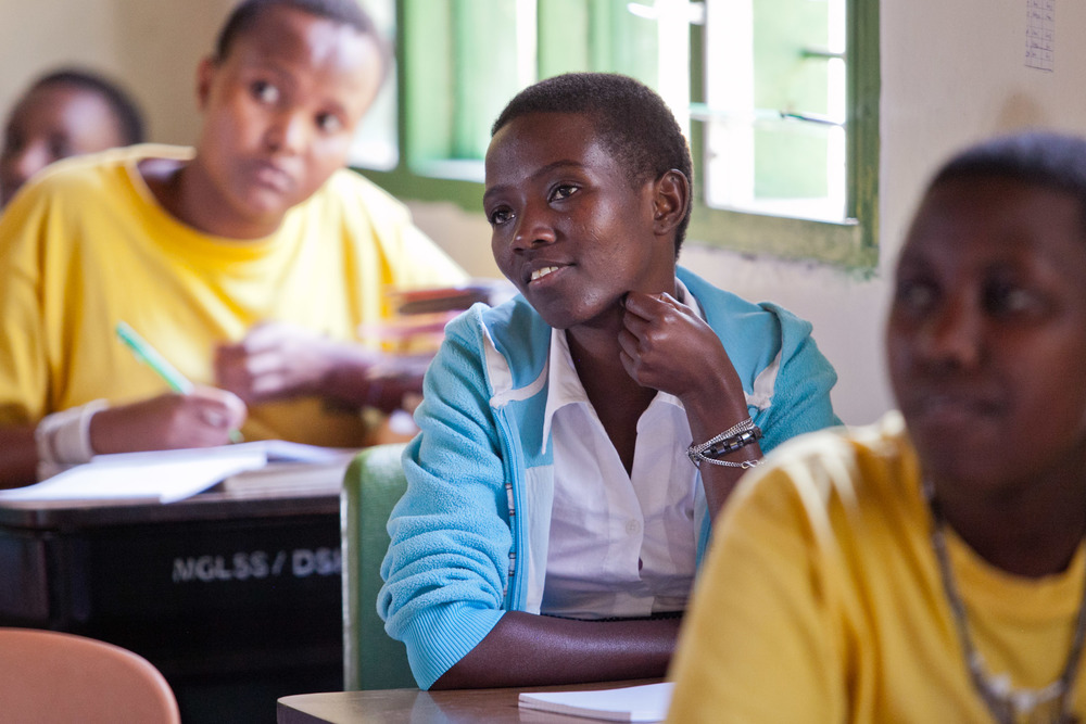 Flora, an 18-year-old high school senior, listens to her mentor during Kisa class. She wants to be a wildlife manager after graduation.