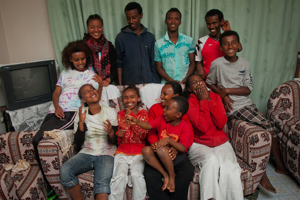 The Selamta family at Bishingiri house, one of eleven Selamta families. Each house is named for a significant person or place in Ethiopia.