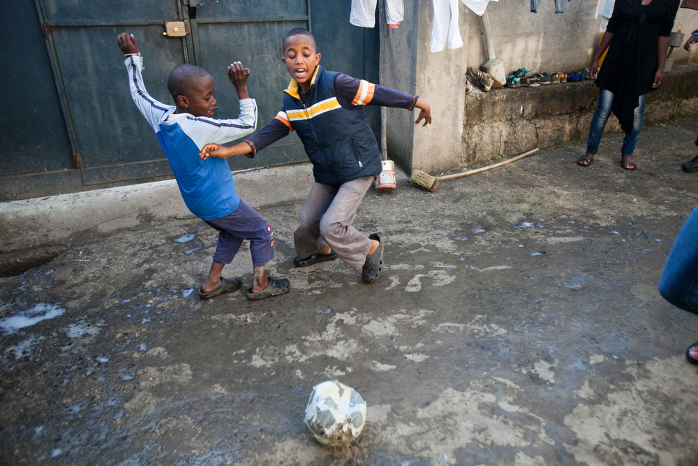 Boys from the Gondar house play soccer in their courtyard.