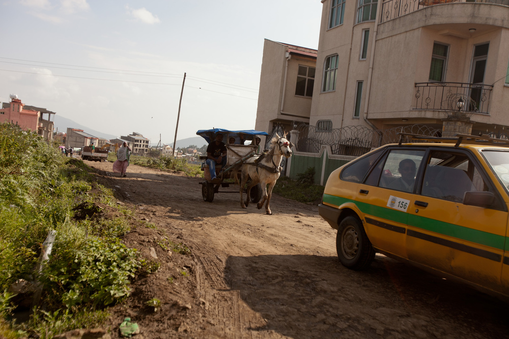 A horse and buggy travels through the suburban neighborhood where the families live near Addis.