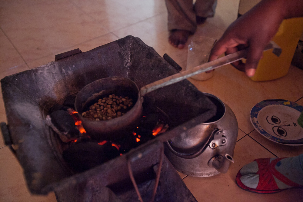 Roasting coffee beans during the daily coffee ceremony.
