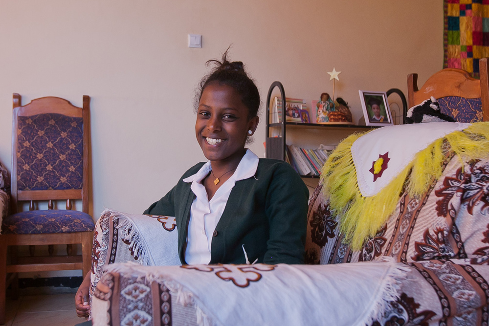 Tizita poses in her home at Gondar house.