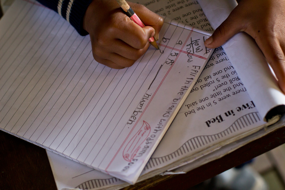 She's the First Scholar and second grader Anisha B. works on odd and even numbers in Math class in Nepal, March 2015. (photo by Kate Lord)