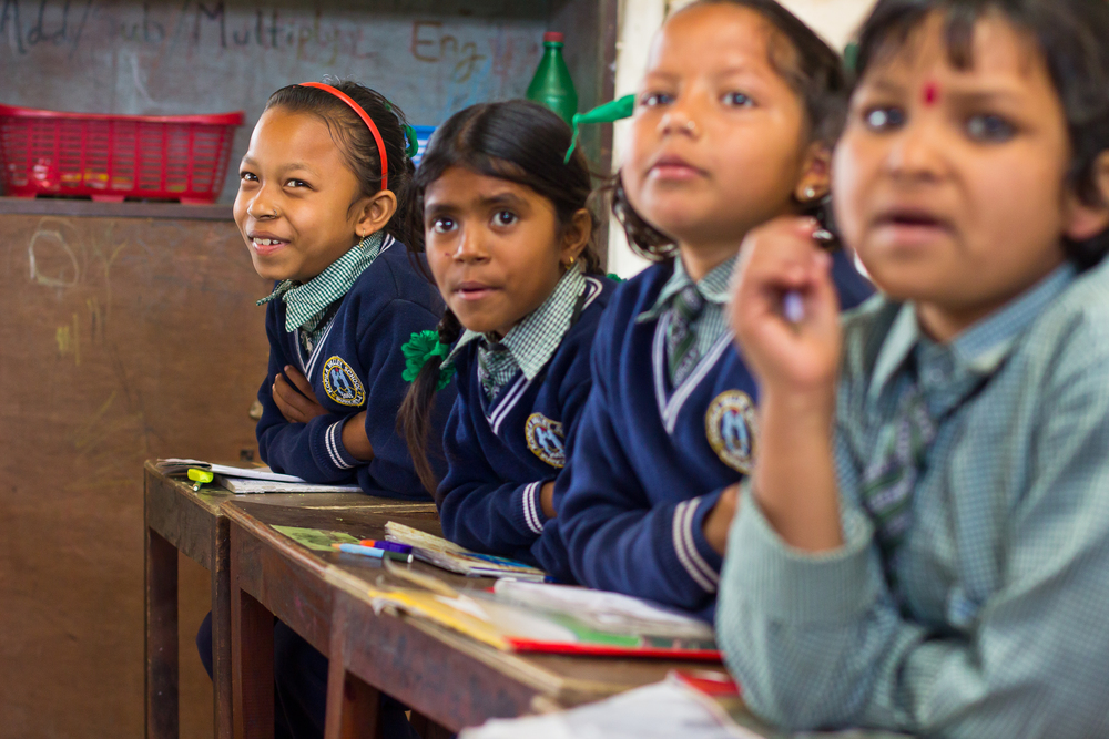 She's the First Scholar Robina C., far left, sings along in her second grade class in Nepal, March 2015. (photo by Kate Lord)