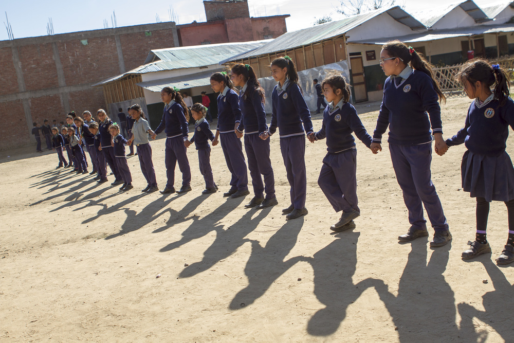 She's the First Scholars line up for a game of Red Rover in Nepal, March 2015. (photo by Kate Lord)