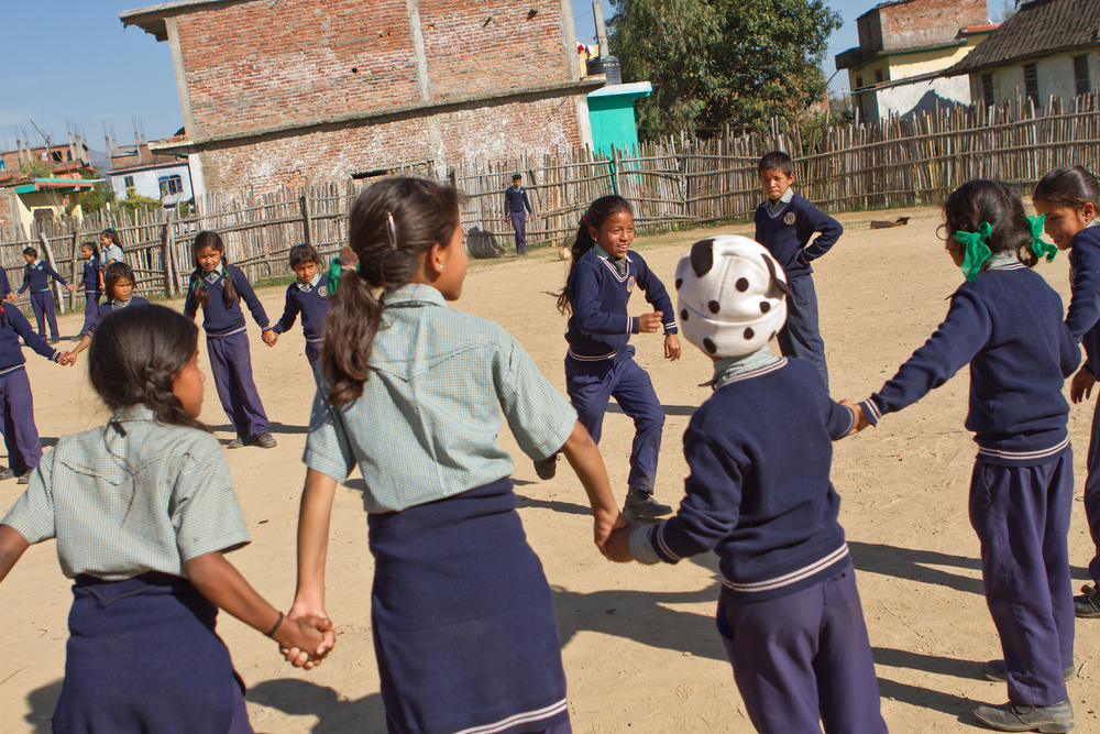 She's the First Scholar Jharana B. runs during a game of Red Rover in Nepal, March 2015. (photo by Kate Lord)