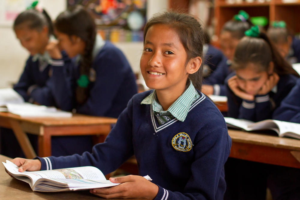 She's the First Scholar and sixth grader Supeksha G. poses in her school's science classroom in Nepal, March 2015. (photo by Kate Lord)