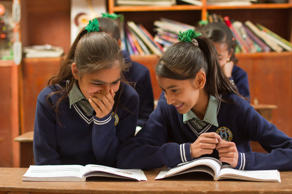 She's the First Scholars Sarita A. and Apeksha K. chat in their school's science classroom in Nepal, March 2015. (photo by Kate Lord)