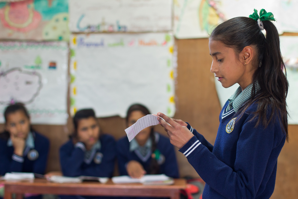 She's the First Scholar Apeksha K. presents to her eighth grade class in Nepal, March 2015. (photo by Kate Lord)
