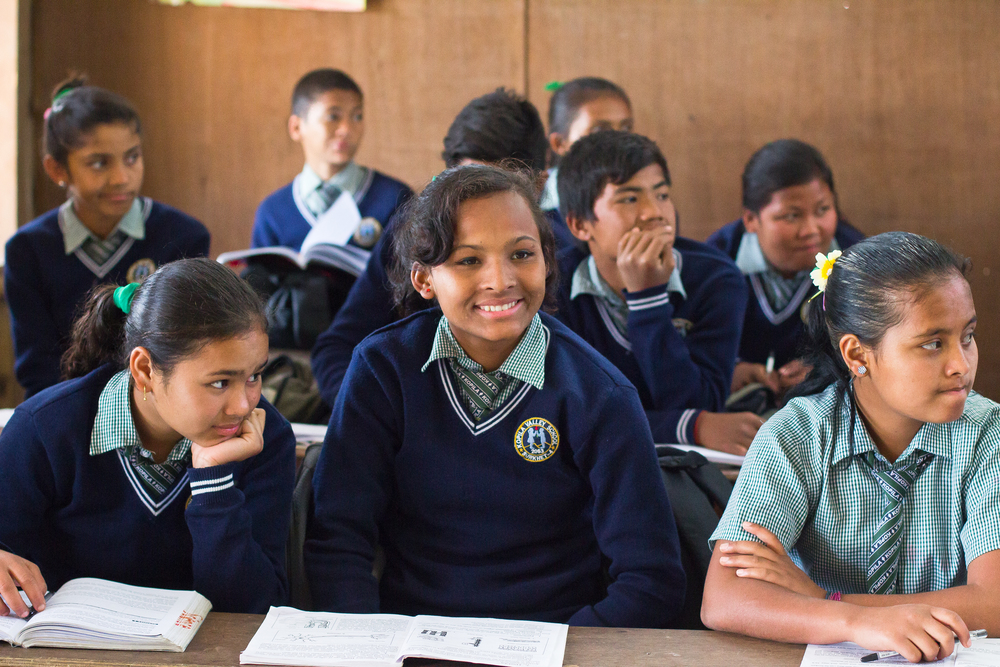 She's the First Scholar Sirjana S., center, listens during her  eighth grade class in Nepal, March 2015. (photo by Kate Lord)