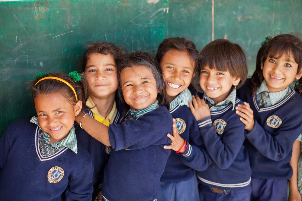 Second graders line up outside their classroom in Nepal, March 2015, including She's the First Scholars (starting third from right), Anisha B, Ganga S., and Tika G. (photo by Kate Lord)