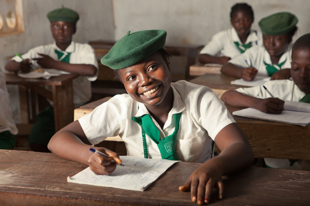 Mariama, a She's the First Scholar in Sierra Leone, poses in her classroom, Nov. 24, 2015. She wants to be a nurse when she finishes school.