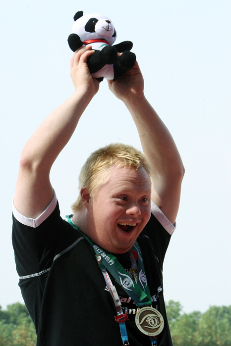 IIpo Holttinen, 29, of Finland celebrates his bronze medal in the 500 meter division nine kayaking finals during the 2007 Special Olympic World Summer Games at Shanghai Aquatic Sports Center.