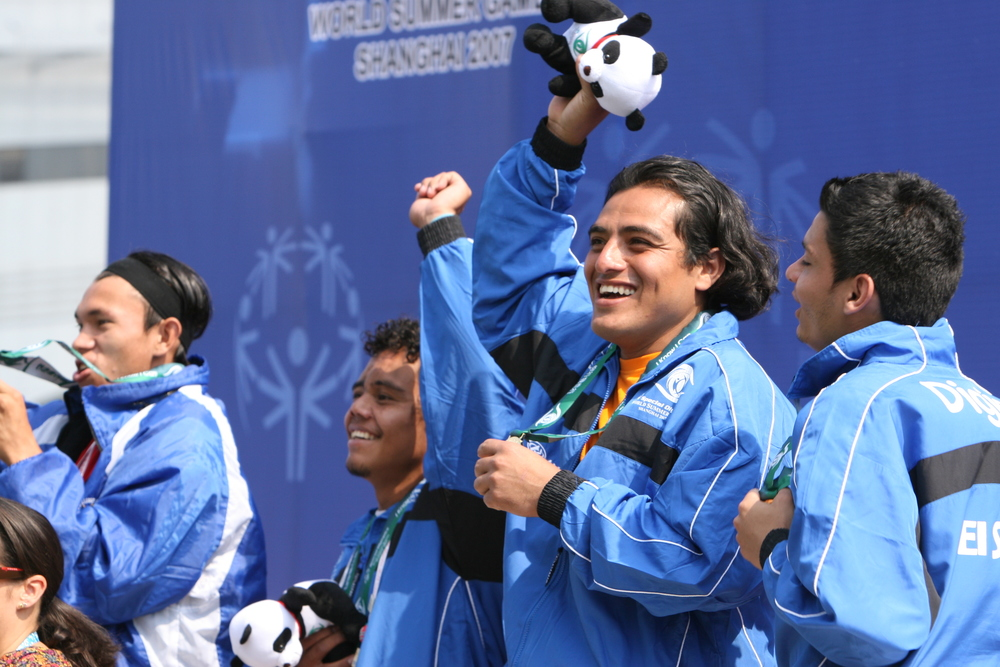 Gustavo Deras, 27, celebrates El Salvador's gold medal in men's 11-a-side football at the award ceremony at Shanghai Songjiang Stadium.