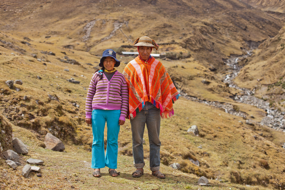 Vicentina and her father pose near their home in the Andes.