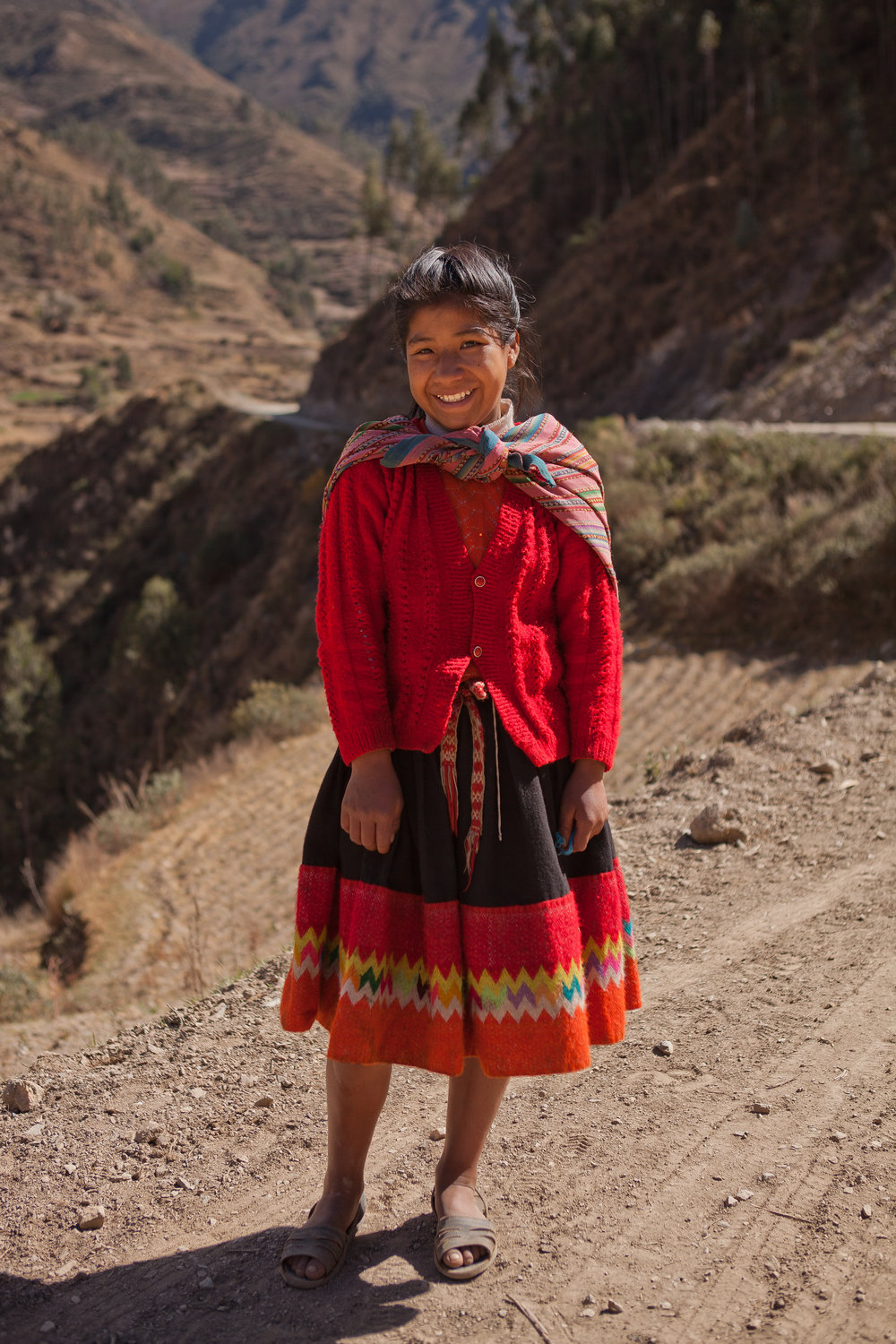 We ran into Elizabeth on her way back home from helping her mom at the market. Elizabeth lives in a rural mountain community, and she lives at the dorm during the week to make her commute to school possible.