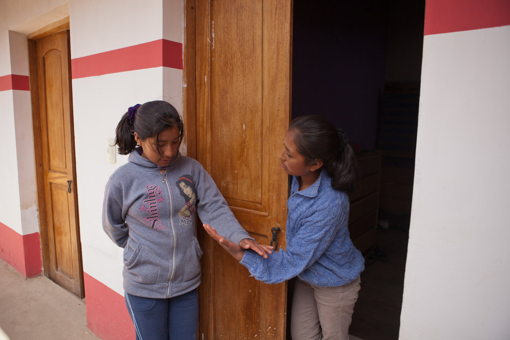 4pm: Back home at the dorm, Elizabeth chats with her friend Mariela. The girls come from villages all over the area to live in the Sacred Valley Project dorm and attend school in Ollantaytambo.