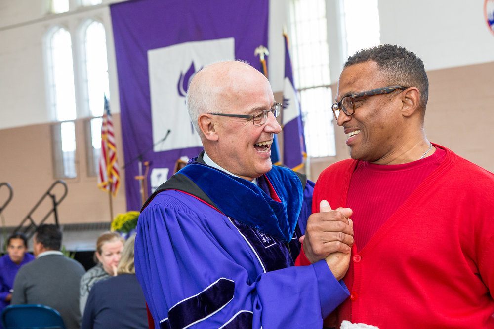 New York University President Andrew Hamilton chats with Anthony Stevens, a current student in the NYU Prison Education Program.