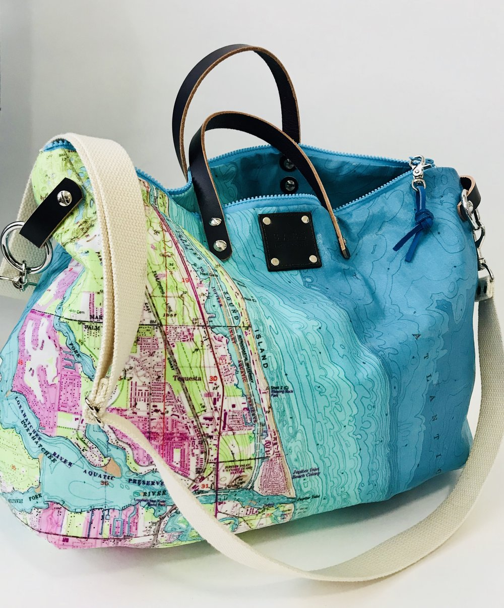 Coastal & City Cruisers - Set your course.....These bags are made from nautical charts and topographic maps printed on treated cotton twill so they are water and dirt resistant.  The collection includes totes, clutches and cross body bags. Contact me for more information about available charts and custom designs.