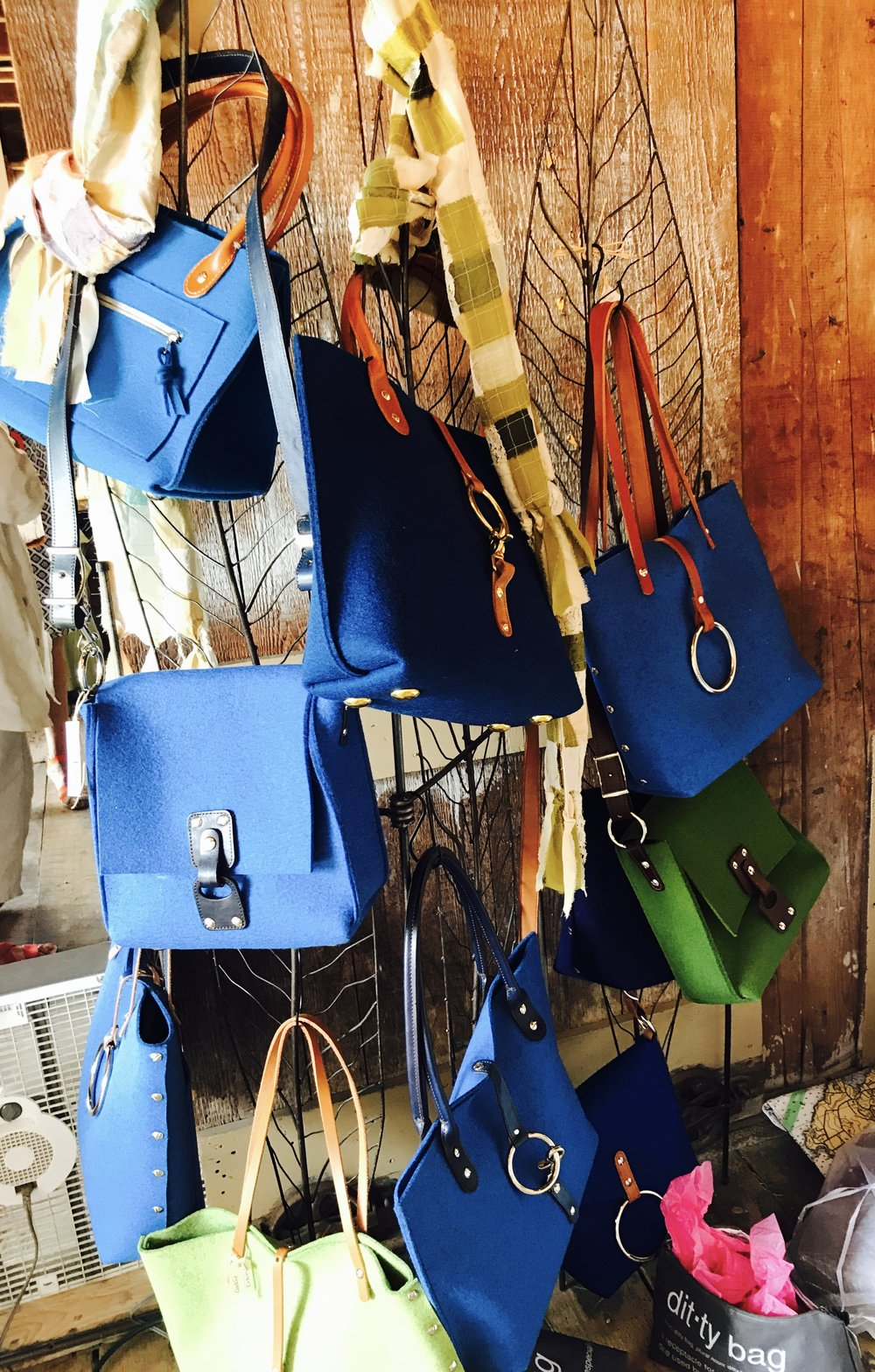 an award-winning collection ofhand-crafted handbags that includes: -