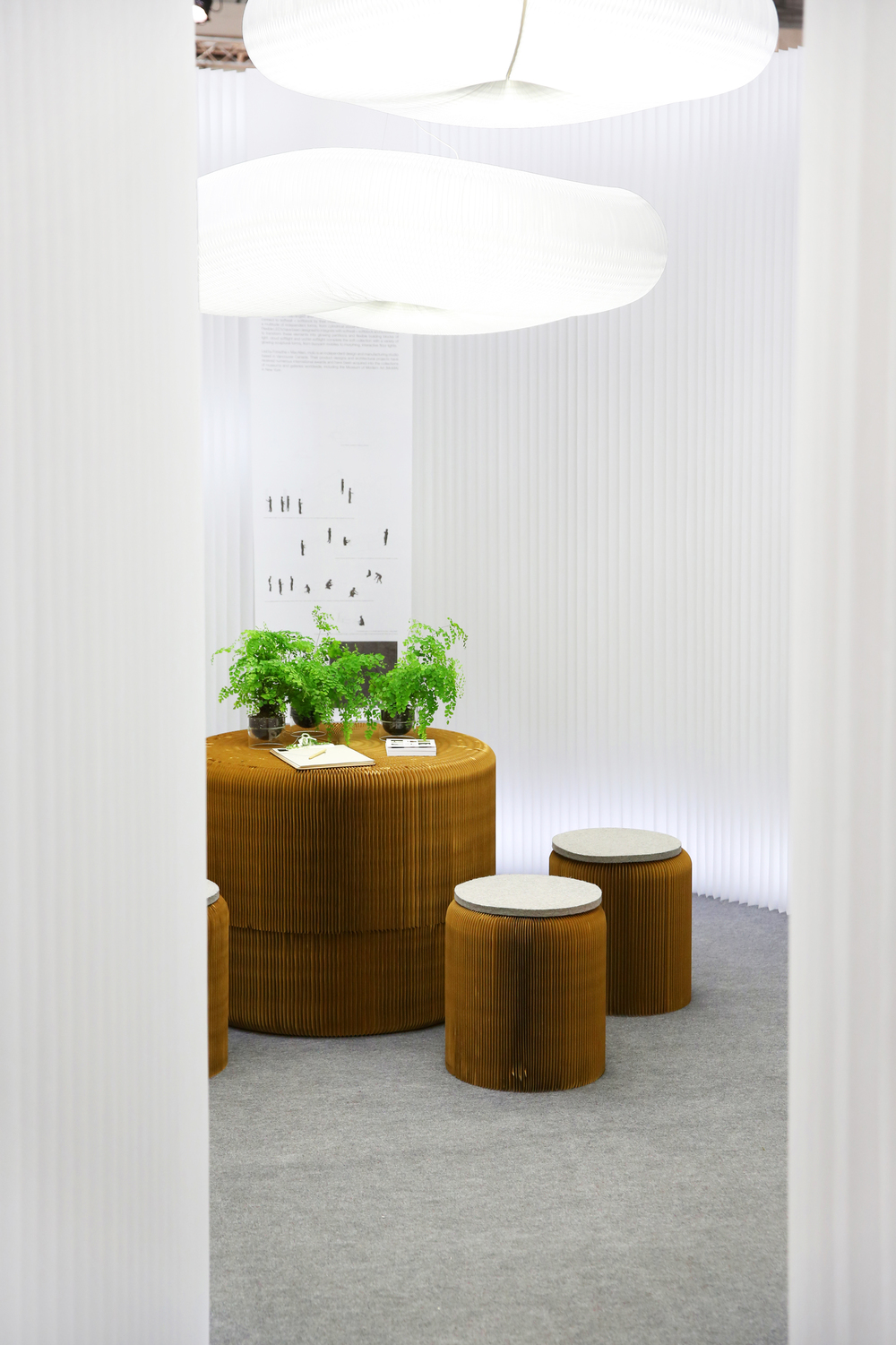 Molo_fanning paper stools + white softwall.jpg