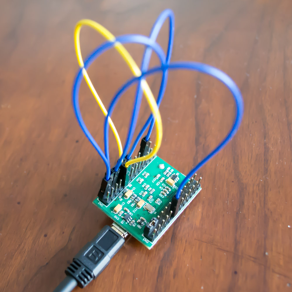 Picture of FT2232H Mini Module with Required Power and Loopback (Yellow) Connections