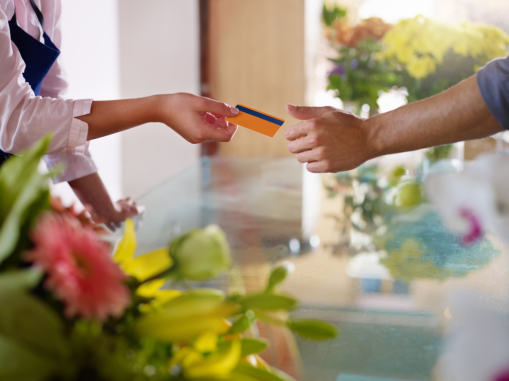 bigstock-Client-With-Credit-Card-Shoppi-23747468.jpg
