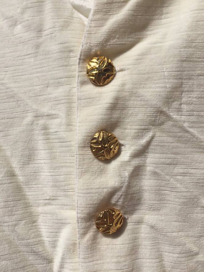 Handsome gold buttons for a handsome prince.