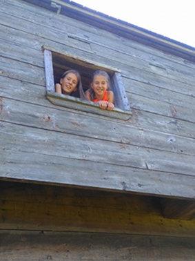Peek-a-boo! Having fun at the Blockhouse. Photo credit: Ally Loiselle