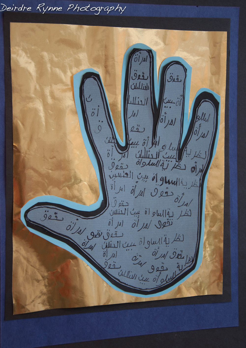 """The three words written on my hand are : feminism, woman and rights. 'Feminism' and 'woman' go hand in hand. A woman in the Middle East wants the same rights as a man; specifically women want the same opportunities to pursue their education as men do. The problem are groups like the Taliban, for example, threaten women that if they should go to school, they would be killed. Student 2013"
