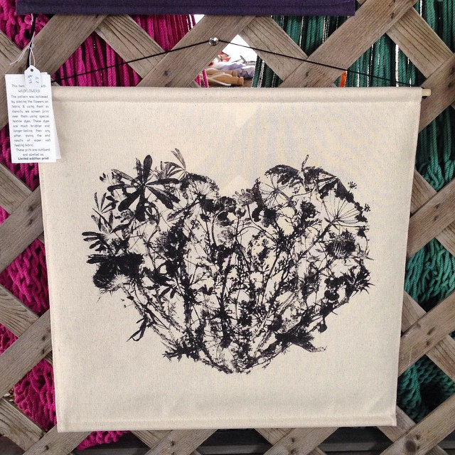 Today the weather was so brutal I don't think we'll make it to the @ithacafarmersmarket market again this season - this picture was taken on a nice sunny day at the market. Also I need to print a new batch of our #wildflowers heart #tapestries this one went to ☀️ Texas #textiledesign #planetariumdesign (at Ithaca Farmers Market)