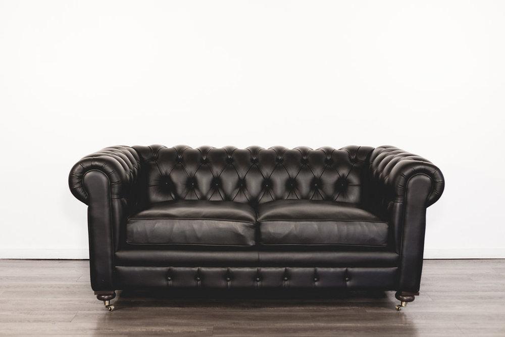 Black Leather Sofa Quantity: 1